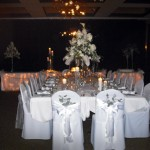 Intimate setting featuring high-style all white arrangements.