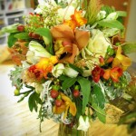 Distinctive bridal bouquet with Kale, Dusty Miller, and Cymbidium Orchids.