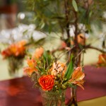 Votives filled with flowers are sweet favors for guests and add color to the table.