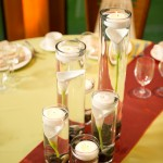 Classic and sleek, submerged Calla Lillies in cylinders with floating candles.