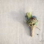 Succulent boutonniere finished with twine.