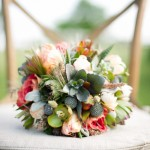 Garden flowers, succulents, and metallic accents mix in this bouquet.