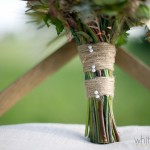 Twine and coupled pearl pinheads finish this bohemian and rustic yet refined bouquet.