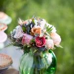 Beautiful, soft, and romantic, this bouquet features garden flowers in peaches and corals with succulent and metallic accents.