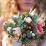 Sunlight highlights the various textures of this succulent bouquet.