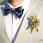Mat displays his boutonniere of succulents, metallic Billy Balls, and greenery.