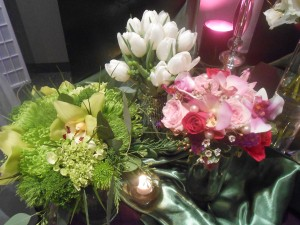 A collection of spring bouquets in shades of green, white tulips, and shades of pink.