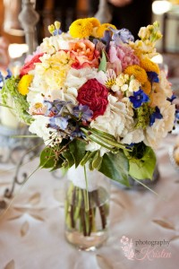 Simply beautiful bridal bouquet of wildflowers in cream and pops of color.  Photo by: Photography by Kristen