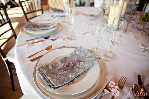 A sprig of Heather adds the finishing touch to an elegant place setting. Photo by: Photography by Kristen