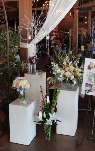 This grouping of plaster pillars showcases beautiful bouquets and arrangements.