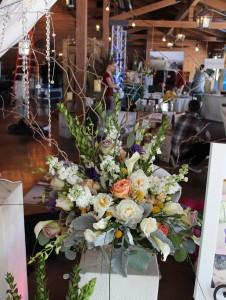 Arrangement of premium flowers in a mercury glass urn.