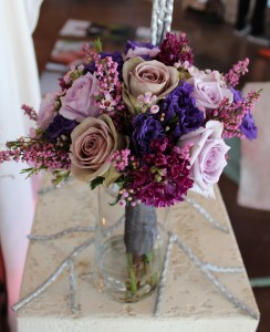 Shades of purple bouquet with lavender Roses, Heather, Hyacinth, and Lizianthus.