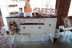 Adorable buffet as a sweets display in pinks and peaches.