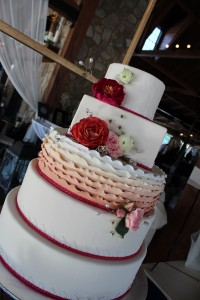 This awesome cake was complemented by Roses, Peonies, and Ranunculus.