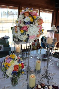 These distressed, crystal embellished candlesticks are perfect combined with romantic wildflower centerpieces in cream, coral, blush, yellow, and blue.