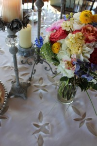 A handmade linen tablecloth was the perfect detailed foundation for this tablescape and wildflower bouquet.
