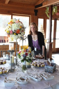 Manager and designer Erin Stoffregen with her floral creations for a tablescape at Rockford Wed 2013.