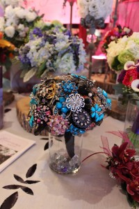 This brooch bouquet is brightened by a pop of turquoise.