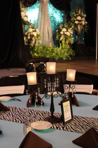 A black candelabra with crystals as a rental centerpiece on a guest table.