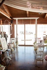 A trellis with a handcrafted log swing is a whimsical non-traditional altar ceremony setting. Photo by: Photography by Kristen