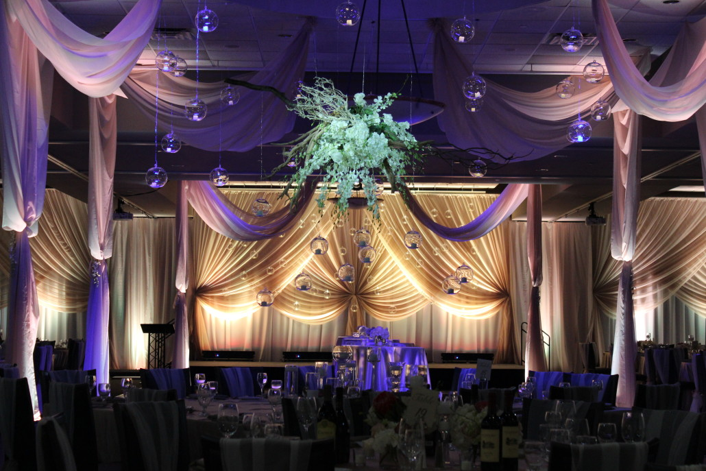 The entire room was draped in floor to ceiling drape, with specialty backdrops and doorway treatments accenting the room.