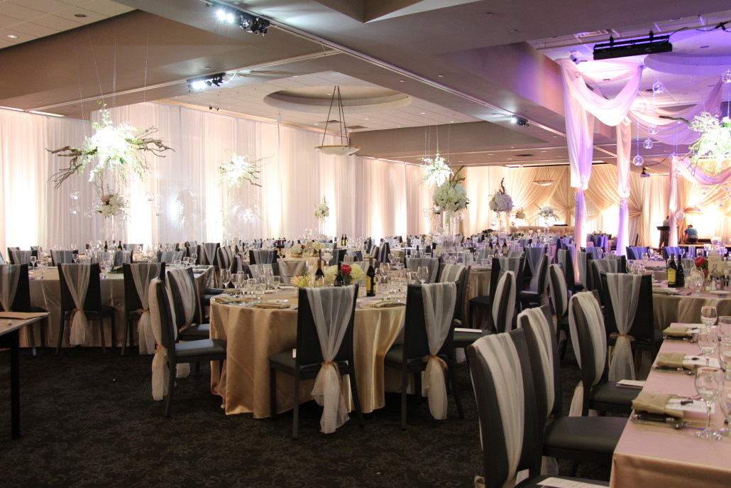 The tables were dressed in specialty champagne linens. Event Floral had custom sheer ivory chiffon chair sleeves made to dress up the chairs.